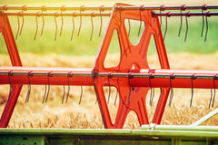 Combine harvester revolving reel harvesting wheat crops Royalty Free Stock Photography
