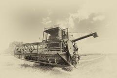 Combine harvester in sepia technique Stock Image