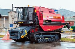 Combine harvester in stock. Stock Photo