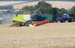 Combine harvester transfering corn. Royalty Free Stock Image