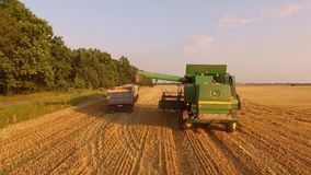 Combine harvester and truck. stock video footage