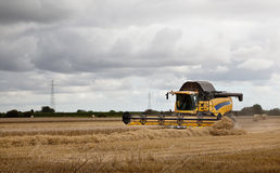 Combine Harvester under a heavy sky. Royalty Free Stock Photos
