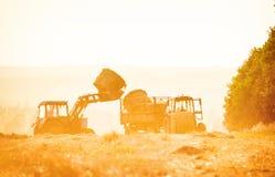 Combine harvester unloading grain into the trucks trailer Royalty Free Stock Image