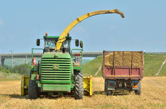 Combine harvester unloading Royalty Free Stock Photo