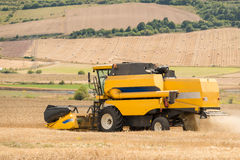 Combine harvester. View of a combine harvesting wheat Royalty Free Stock Photos