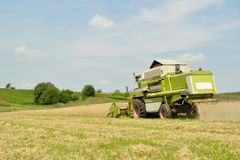 Combine harvester in the wheat field during harves Royalty Free Stock Photos