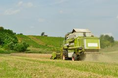 Combine harvester in wheat field during harvesting Stock Photography