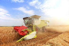 Combine harvester in a wheat field Stock Photo