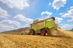 A combine harvester at work on a field. Royalty Free Stock Photography