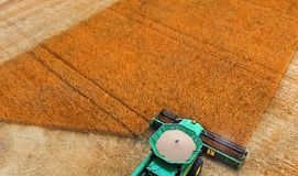 Combine harvester at work on wheat field. Combine harvester at work. Wheat crop harvesting stock photo