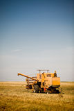 Combine harvester working Royalty Free Stock Image