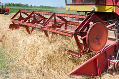 Combine harvester working Stock Images