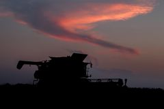 Combine harvester working through the night Stock Images