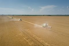 Combine harvester working on a wheat field. Combine harvester Aerial view. royalty free stock photo
