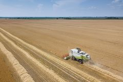 Combine harvester working on a wheat field. Combine harvester Aerial view. Combine harvester working on a wheat field. Combine harvester Aerial view stock image