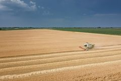 Combine harvester working on a wheat field. Combine harvester Aerial view. Combine harvester working on a wheat field. Combine harvester Aerial view royalty free stock photography