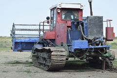 Rice header combine harvester. Combine harvesters Agricultural machinery Old rusty combine harvester. Rice header combine harvester Stock Images