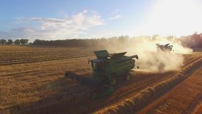 Combine harvesters and dust stock footage