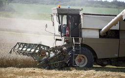 Combine harvesting a field of wheat Royalty Free Stock Photography