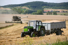 Combine harvesting a field of wheat Stock Photography