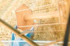 Combine harvesting field Stock Image