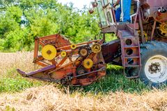 Combine harvesting mature wheat crops Royalty Free Stock Images