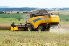 Combine harvesting rape Royalty Free Stock Photography