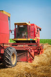 Combine harvesting wheat Stock Photos