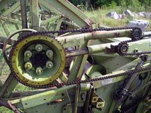 Combine header transmission. Vintage combine header chain transmission, left side Royalty Free Stock Photos