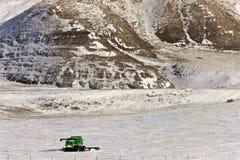 Combine and hills in Winter. Saskatchewan Stock Photography