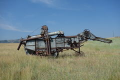 A combine in idaho with a blue sky in the background. Royalty Free Stock Photo