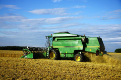 Combine machine during harvest time. Cutting straw Royalty Free Stock Images