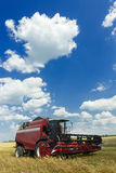 Combine machine with header or cutting blade standing in oat farm field Stock Photos