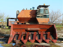 Combine rusts open-air. The old written off combine rusts open-air stock photo