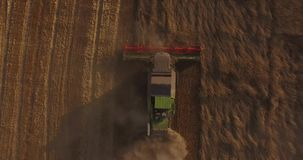 Combine harvests the land stock video footage