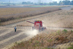 Combine in soybean field Royalty Free Stock Image