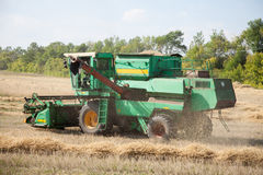 The combine to harvest on the field. Royalty Free Stock Photo