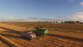 Combine unloading grain into truck stock video footage