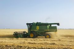 Combine on wheat field Stock Photos