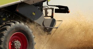 Combine Working In The Field. Take Off The Waste Of The Harvest From The Back Of The Combine During The Harvest. Prores. Slow Motion, 4k. Close Up stock footage