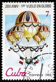 Combined balloon of Eugene Godard, 1850, Bicentenary of Aeronautics serie, circa 1983. MOSCOW, RUSSIA - NOVEMBER 10, 2018: A stamp printed in Cuba shows Combined royalty free stock photo
