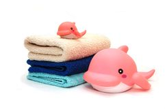 The combined colour towels with toy Stock Images