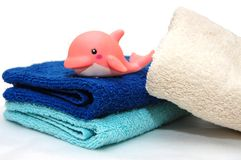The combined colour towels with  toy Royalty Free Stock Photography