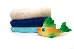 The combined colour towels with toy Fish Stock Photo
