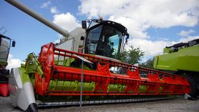 Combined harvester. Agriculture harvest machine against blue skye stock photography