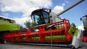 Combined harvester. Agriculture harvest machine against blue skye royalty free stock images