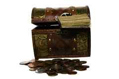 The combined money. The combined together present working paper money and coins about a chest Royalty Free Stock Photography