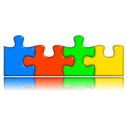 Combined multi-color puzzle with reflection Royalty Free Stock Image
