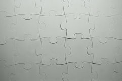 The combined parts of a grey puzzle Royalty Free Stock Image