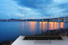 Shenzhen Bay Bridge over laptop